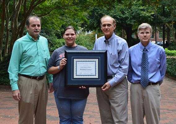 Brittany Lowery, a student at North Carolina State University, receiving her certificate of completion of Swine Science Online, from Dr. Todd See, Dr. Ken Esbenshade and Dr. Billy Flowers