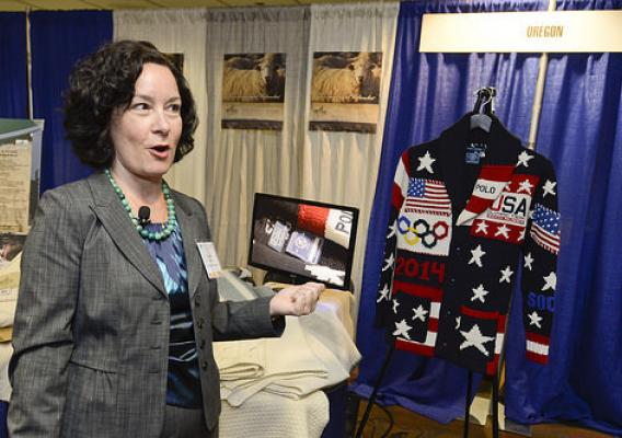 Rural Development Deputy Under Secretary Patrice Kunesh admiring an official USA Winter Olympic Team sweater made with wool from the Imperial Stock Ranch in Shiniko, Oregon.