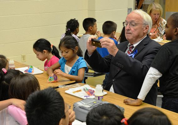 Under Secretary Kevin Concannon taking a photo of his lunch mates at Arcola Elementary School in Silver Spring, Md.
