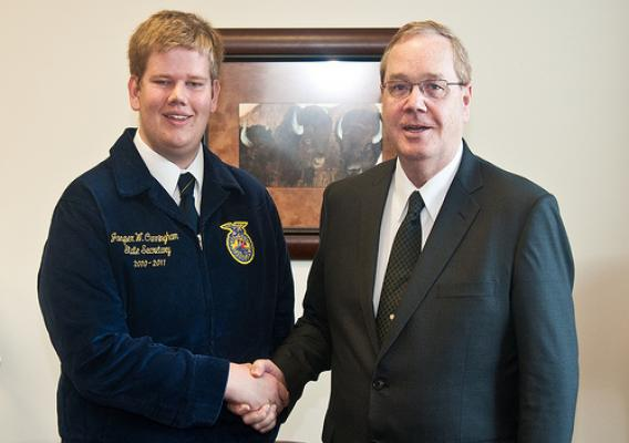 Jasper Cunningham, Michigan FFA National Officer candidate, Junior at Michigan State University, and owner of the Seed Boy Seed Company (left) meets with Agriculture Under Secretary for Rural Development Dallas Tonsager at the Agriculture Department.