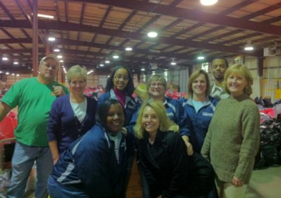 Rural Development Tennessee State Office staff help to distribute gifts at the Salvation Army  distribution center:  Shown, Keith Head, Kathy Connelly, Fallan Faulkner, Melba Baxter, Cheryl Myhand, Taylor Marable, Terri Sneed, Abby Boggs, and Kathy Smith.