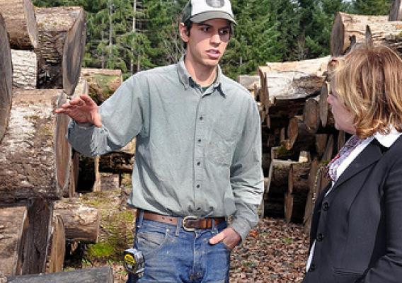 Zena Forest Products' owner and Value Added Producer Grant recipient, Ben Deumling, explains the uses and values of different sizes of sustainably harvested Oregon white oak to USDA Rural Development Administrator for Rural Business Service Lillian Salerno at the company site near Salem, OR.