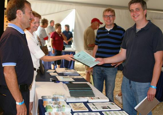 USDA Officials handing out program information during the 2012 South Dakota State Fair.