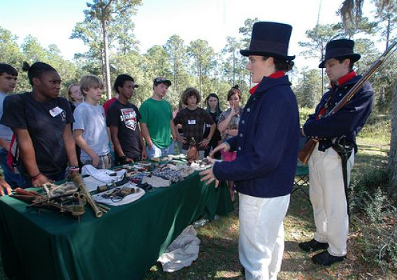 Juliann and Matthew Krogh, members of the Coast Guard Historic Ship's Company, give a living history presentation to Franklin County, Fla., middle school students recently at historic Fort Gadsden on the Apalachicola National Forest. (U.S. Forest Service Photo/Susan Blake)