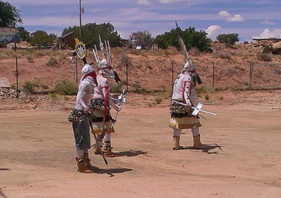 Members of the Apache Crown Dancers celebrate the opening of The Navajo Nation's new chapter house/multi-purpose center.
