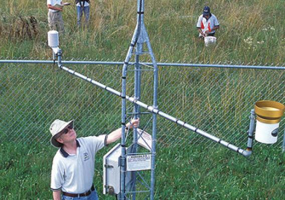 Tom Jackson, shown here at a Soil Climate Analysis Network site in Huntsville, Alabama coordinates in situ soil moisture networks as part of several satellite remote sensing programs, including the recently launched Soil Moisture Active Passive (SMAP) Mission.  Dr. Jackson is currently stationed at NASA's Jet Propulsion Laboratory in Pasadena, California helping the SMAP Science Team produce a calibrated and validated global soil moisture product. USDA ARS Photo.