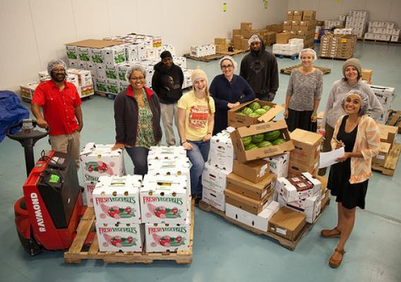 The Common Market team, led by founders Haile Johnston (far left in red shirt) and Tatiana Garcia-Granados (far right in orange sweater), brings food into Philly communities by connecting Mid-Atlantic farmers with wholesale customers. Photo courtesy Common Market.