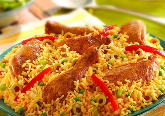 Image of rice with chicken on plate.