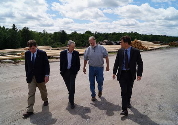 Administrator Sam Rikkers touring the lumber yard