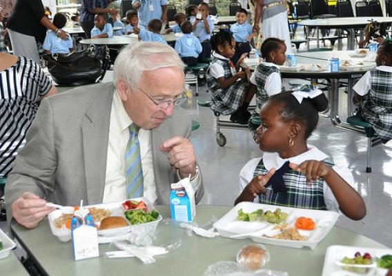 Under Secretary for Food, Nutrition, and Consumer Services Kevin Concannon sharing a healthy lunch with a kindergarten student at Mahalia Jackson Elementary School
