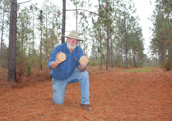U.S. Department of Agriculture's (USDA) Natural Resources Conservation Service (NRCS) Mississippi soil conservation technician Allen Hughes displays baskets made from Southeastern longleaf pine needles in Poplarville, MS