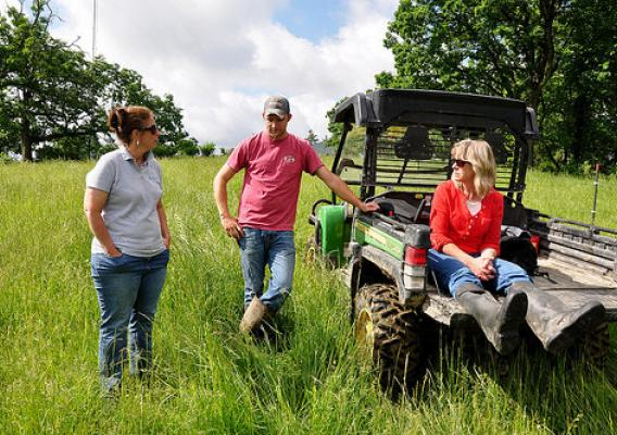 Ryan Collins (center) with NRCS District Conservationist LuAnn Rolling (right) and Iowa NRCS State Public Affairs Specialist Laura Crowell