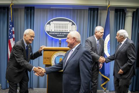 USDA Former Secretaries and Secretary Perdue shaking hands at USMCA press conference