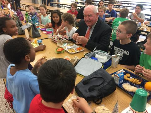Secretary of Agriculture Sonny Perdue eats lunch with students at Catoctin Elementary School.