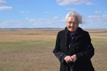 An old woman standing in a field