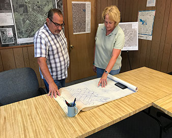 Two people discussing a project plan